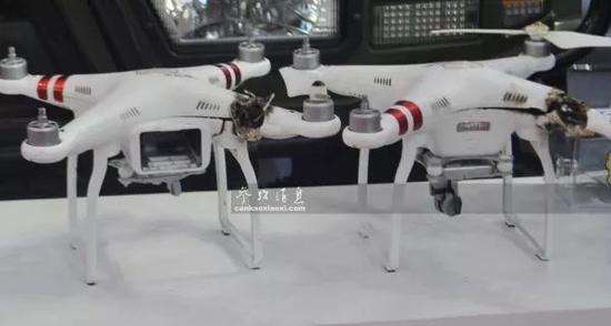 """▲厂商在航展现场展出的""""激光净空系统""""烧毁的无人机,可见光束毁伤部位十分精确。"""