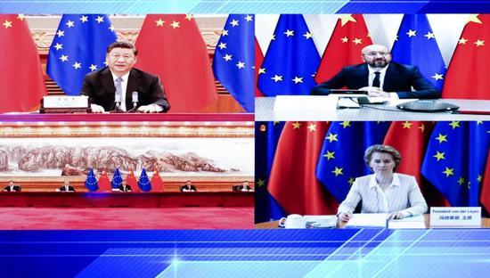 6月22日,习近平在北京以视频方式会见欧洲理事会主席和欧盟委员会主席(图源:新华社)