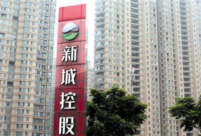 在新城控股危急时刻而临危受命的王晓松,面临着如何重塑品牌形象、巩固现金流等难题。 图/视觉中国