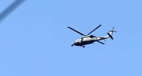 11日上午,韩军直升机在基地上空盘旋