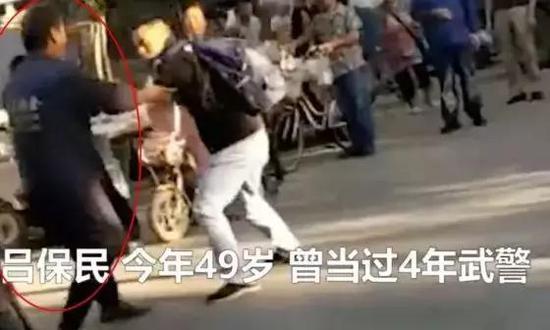 吕保民(左)