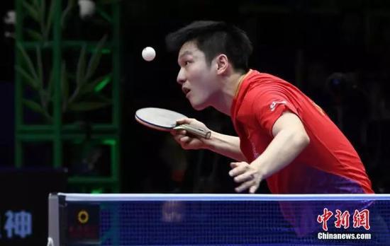 资料图:中国选手樊振东在比赛中。安源 摄
