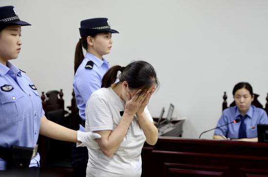 廖某在法庭上受审。新京报记者 郑新洽 摄