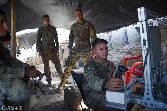 驻守阿富汗的北约军事(贪图源:视觉中国)