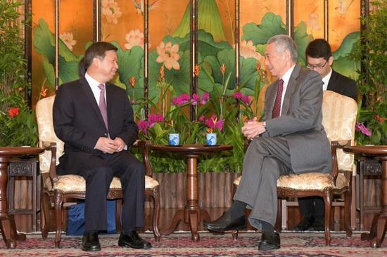 3月25日,新加坡人民行动党秘书长、政府总理李显龙在新加坡会见中共中央对外联络部部长宋涛。图片来自中联部网站