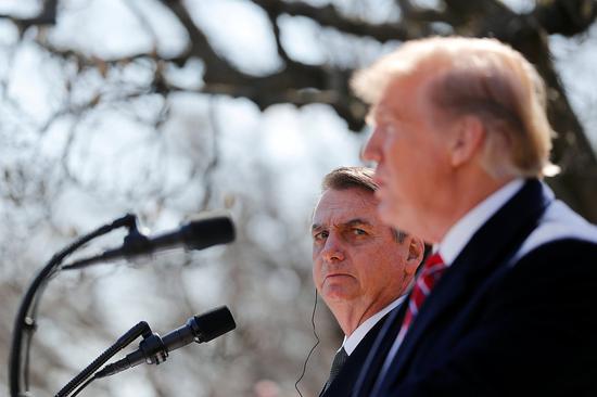 3月19日,特朗普與博爾索納羅在白宮出席聯合新聞發布會 圖源:視覺中國