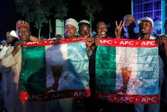 尼日利亚现任总统穆罕默德·布哈里支持者在庆祝 图源:路透社