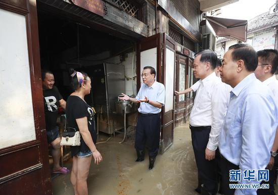 李克强在重庆考察:做好防汛救灾和恢复重建工作