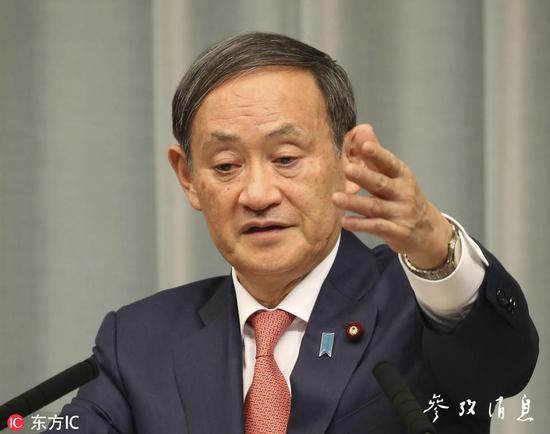 菅义伟在记者会上宣布退出IWC,图片来源:东方IC。