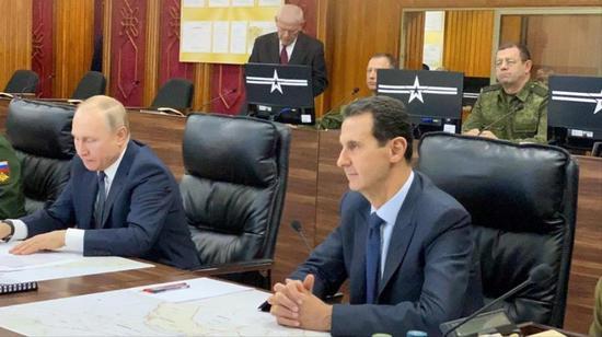 """普京突访叙利亚,与阿萨德讨论了""""恢复叙利亚国家实体及统一叙利亚领土""""的问题 图自路透社"""