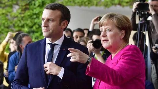 ▲原料图片:2017年5月15日,德国总理默克尔在柏林会晤到访的马克龙。(法新社)