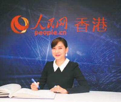 图为邝美云接受人民网香港分公司采访。吴玉洁摄