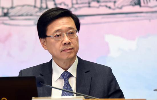 图为香港保安局局长李家超表示