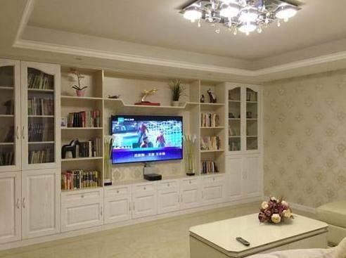 16萬裝修125平新房, 電視墻打滿柜子超實用, 鄰居回家圖片