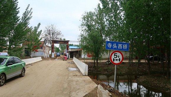 袁平年为村里修建的桥。摄影:黎文婕