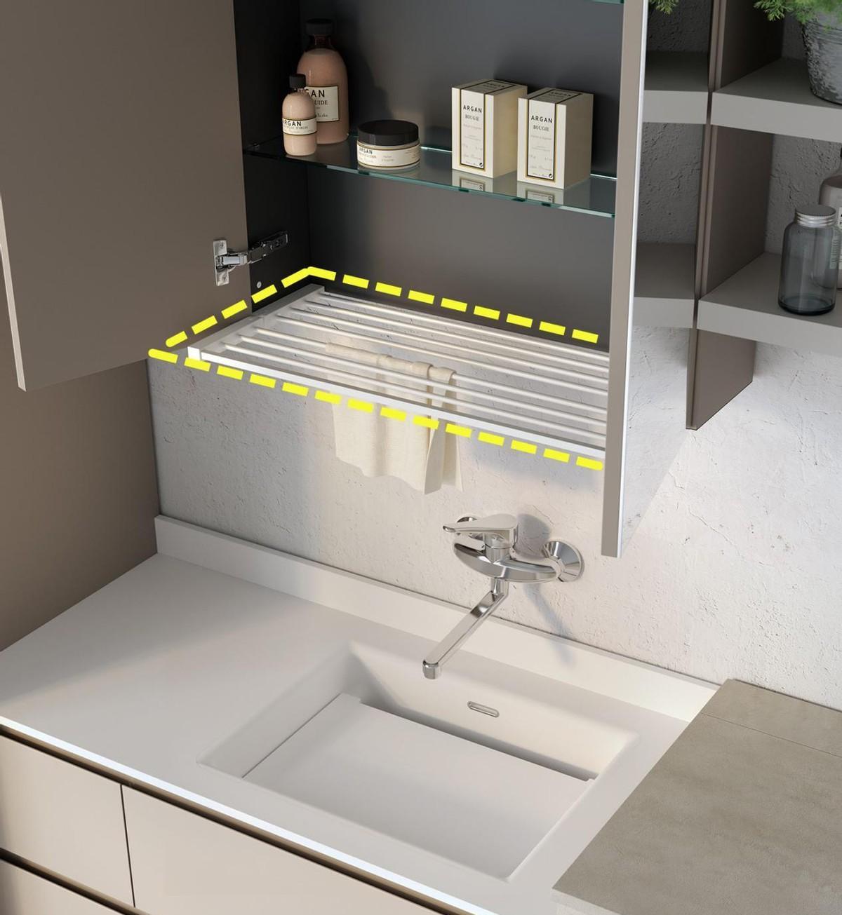 镜柜底部省去一块板,用沥水架做镂空,柜门一关,台面上清清爽爽