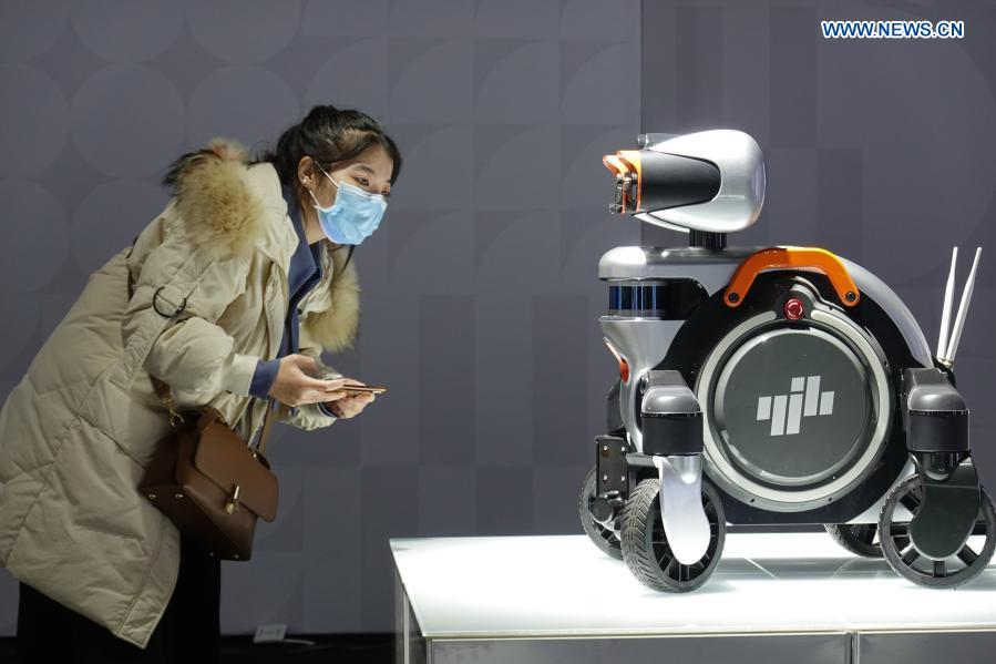 A visitor views a smart inspection robot at an industrial design exhibition during the 2020 World Industrial Design Conference in Yantai, east China's Shandong Province, Nov. 25, 2020. The 2020 World Industrial Design Conference is held from Nov. 25 to 29 in Yantai. The conference also includes an exposition of China's top industrial designs, with over 800 domestic companies showcasing over 1,000 exhibits of new technology, new design and new products. (Photo by Tang Ke/Xinhua)