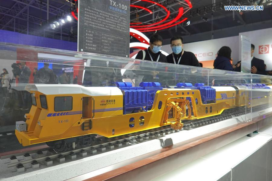 Visitors view the model of a TX-100 rail roadbed suction sewage truck at an industrial design exhibition during the 2020 World Industrial Design Conference in Yantai, east China's Shandong Province, Nov. 25, 2020. The 2020 World Industrial Design Conference is held from Nov. 25 to 29 in Yantai. The conference also includes an exposition of China's top industrial designs, with over 800 domestic companies showcasing over 1,000 exhibits of new technology, new design and new products. (Photo by Tang Ke/Xinhua)