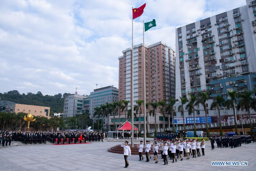 A flag-raising ceremony marking the 21st anniversary of Macao's return to the motherland is held at the Golden Lotus Square in Macao, south China, Dec. 20, 2020. (Xinhua/Cheong Kam Ka)