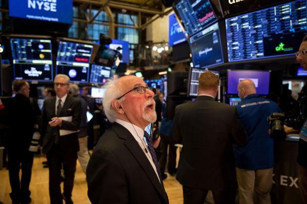 ▲3月16日,交易员在纽约证券交易所工作。(新华社)