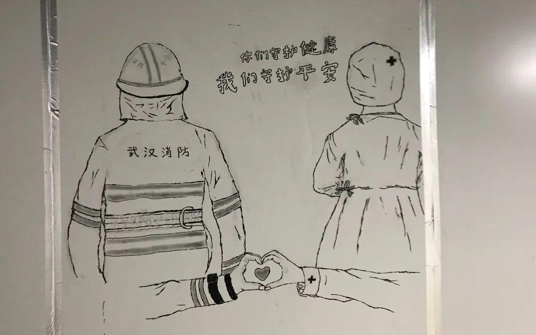 雷神山医院走廊涂鸦墙上的卡通画。受访者供图