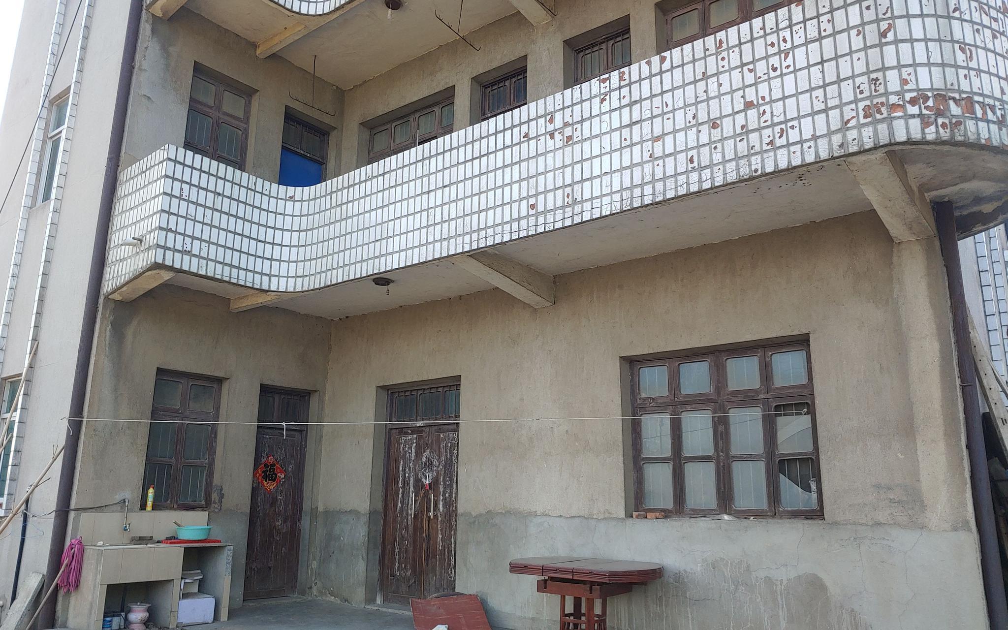 5月12日,老人生前居所门窗紧闭,此前只有老人和保姆在此居住。新京报记者 海阳 摄