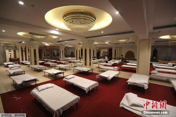 当地时间6月15日,印度新德里,宴会厅被改造为临时医院。</p> <img id=