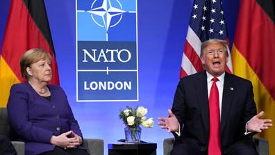特朗普和默克尔在北约峰会期间举行双边会晤。图源:路透社