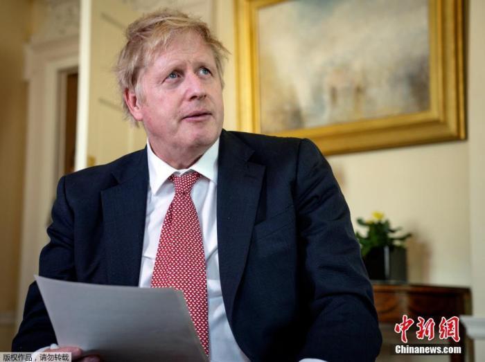资料图:英国首相约翰逊。 <p cms-style=
