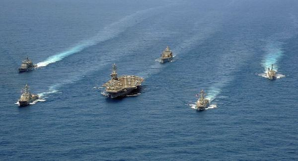 美国海军是围绕着航母打造的,战舰由其在航母战斗群里的作用定义