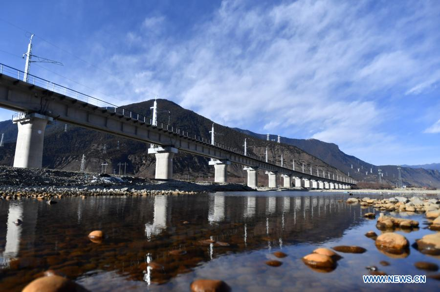 Photo taken on Dec. 27, 2020 shows a bridge of Lhasa-Nyingchi section of the Sichuan-Tibet Railway in southwest China's Tibet Autonomous Region. The track-laying work was completed on Thursday for a railway linking the cities of Lhasa and Nyingchi in southwest China's Tibet Autonomous Region. (Xinhua/Chogo)