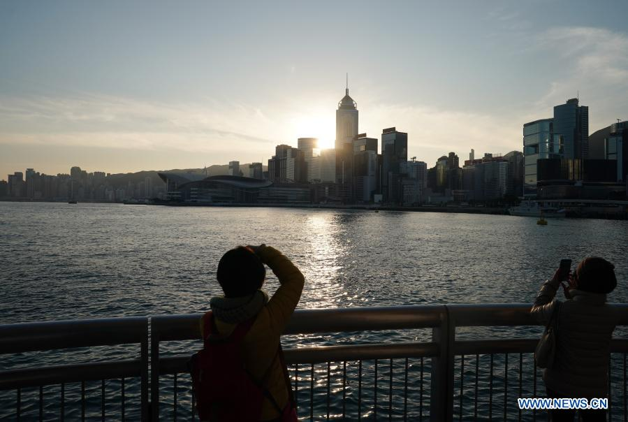 People watch the sunrise at the Victoria Harbor in Hong Kong, south China, Jan. 1, 2021. (Xinhua/Li Gang)