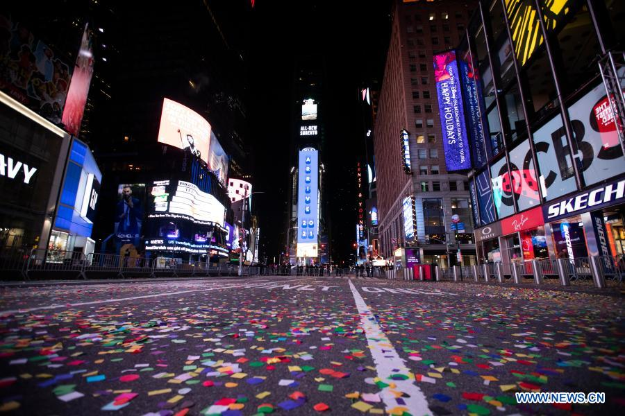 Confetti is seen on Times Square after the New Year celebration, in New York, the United States, Jan. 1, 2021. The Times Square New Year celebration went virtual, with no public audience physically attending the event, to help avoid the spread of COVID-19. (Xinhua/Wang Ying)