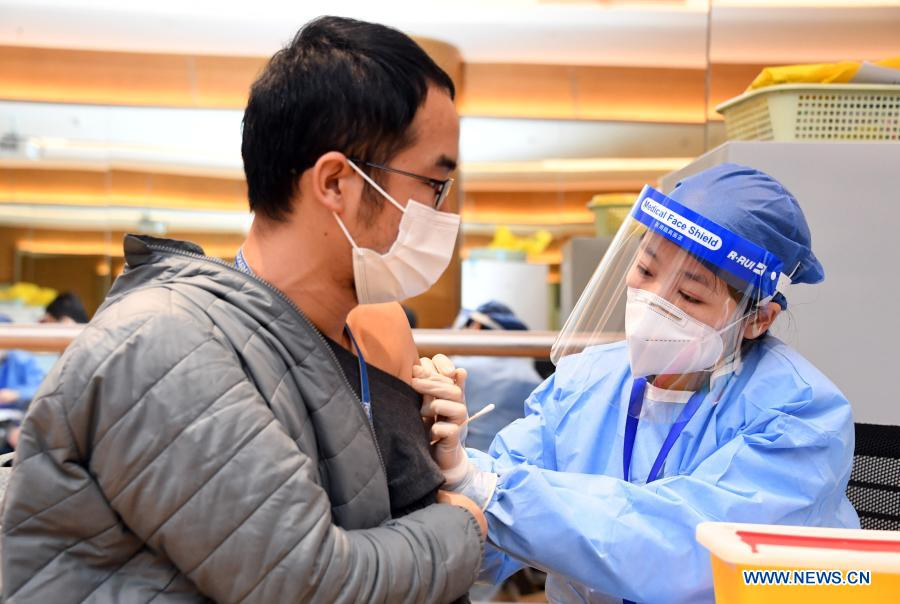 A man receives a shot of COVID-19 vaccine at a temporary vaccination site at a company in the ZPark Phase 2 in Haidian District of Beijing, capital of China, Feb. 22, 2021. It is expected to take two days to complete the vaccination of more than 3,800 employees of the enterprise. (Xinhua/Ren Chao)