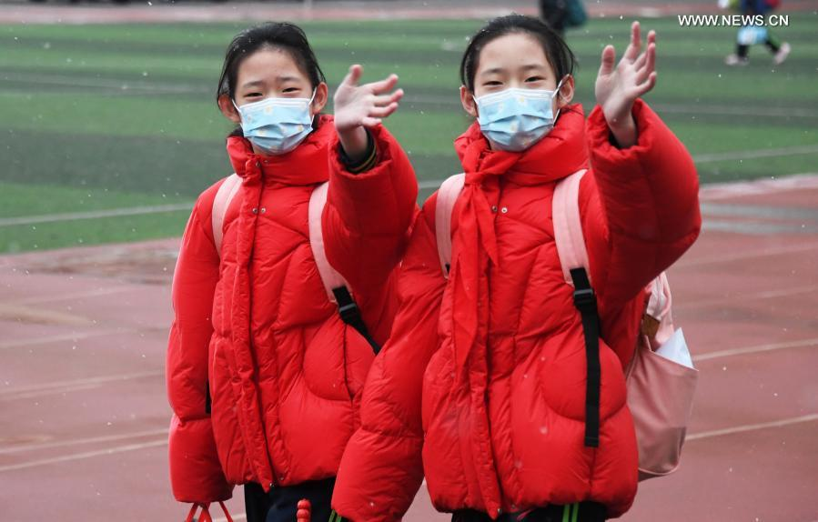 Students walk in the campus of Beijing Taipinglu Primary school in Haidian District of Beijing, capital of China, March 1, 2021. Middle school and primary school students returned to school as scheduled for the spring semester in Beijing on Monday amid coordinated epidemic control efforts. (Xinhua/Ren Chao)