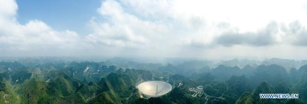 Aerial photo taken on March 28, 2021 shows China's Five-hundred-meter Aperture Spherical Radio Telescope (FAST) under maintenance in southwest China's Guizhou Province. China's FAST officially opened to the world starting Wednesday. (Xinhua/Ou Dongqu)