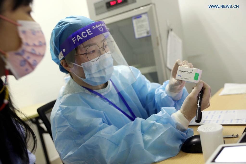 A health worker shows the information on the box of COVID-19 vaccine at a community health center in Malu Town of Jiading new city, east China's Shanghai, April 19, 2021. Shanghai started COVID-19 vaccination for Taiwan compatriots aged from 18 to 75 in the city on Monday following the principle of giving informed consent and voluntary participation. (Xinhua/Liu Ying)