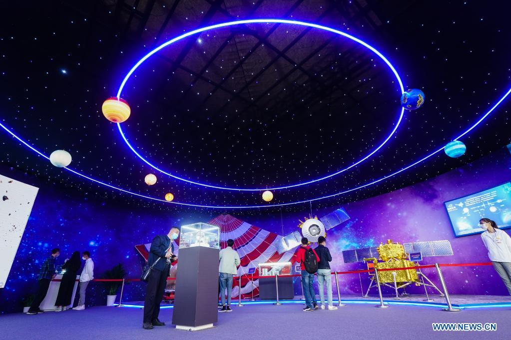 People visit an exhibition featuring space science and achievement during the 2021 China Space Conference in Nanjing, east China's Jiangsu Province, April 24, 2021. The 2021 China Space Conference is held in Nanjing from April 23 to 26. (Xinhua/Ji Chunpeng)