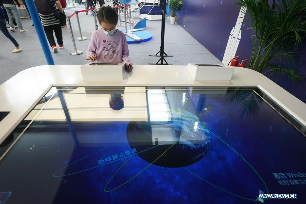 A child experiences satellite designing at an exhibition featuring space science and achievement during the 2021 China Space Conference in Nanjing, east China's Jiangsu Province, April 24, 2021. The 2021 China Space Conference is held in Nanjing from April 23 to 26. (Xinhua/Ji Chunpeng)
