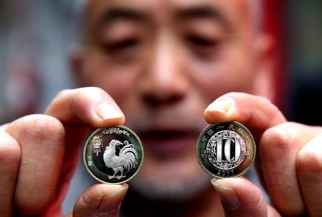 把纪念币当钱花是一种什么样的体验?