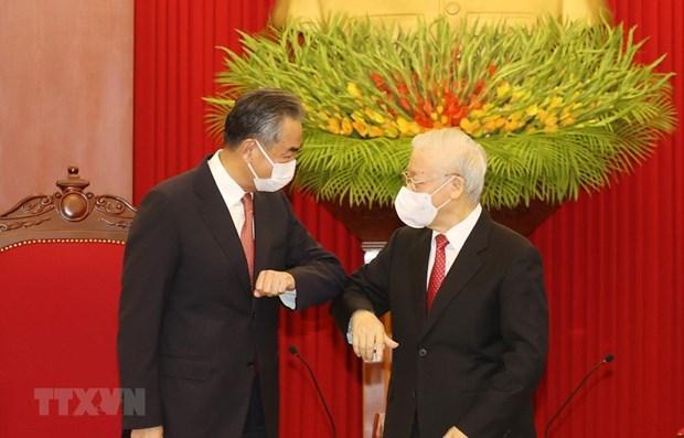 中国国务委员兼外交部部长王毅与越共中央总书记阮富仲。图自越通社