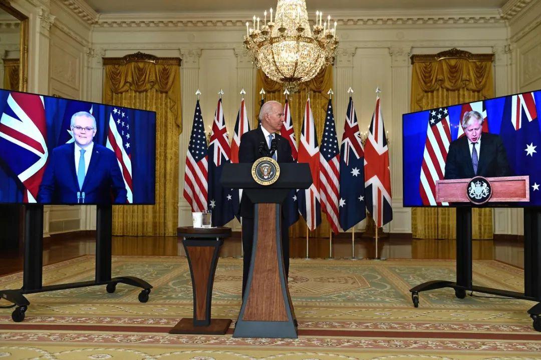 莫里森(左)、拜登(中)、约翰逊召开视频会议。图源:美媒