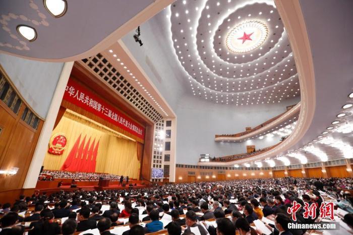 3月5日,第十三届全国人民代表大会第四次会议在北京人民大会堂开幕。 中新社记者 刘震 摄