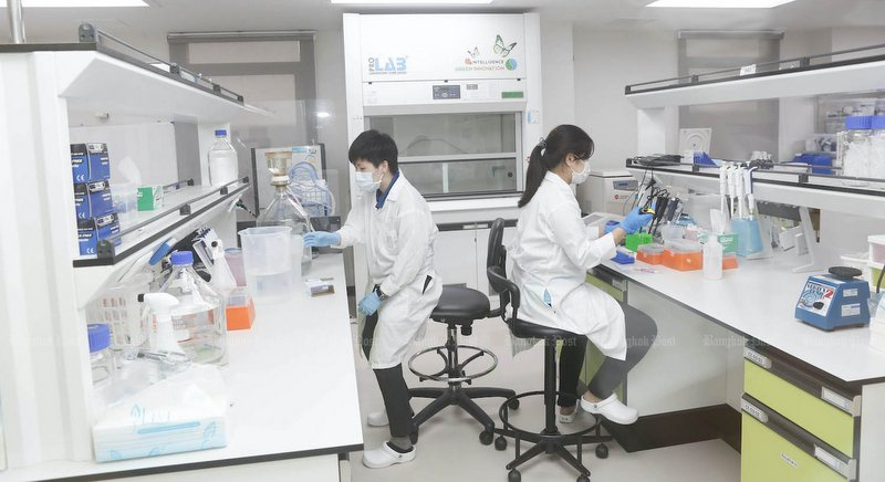 Researchers of Siam Biotech Company work in a laboratory in Bangkok. Picture from: