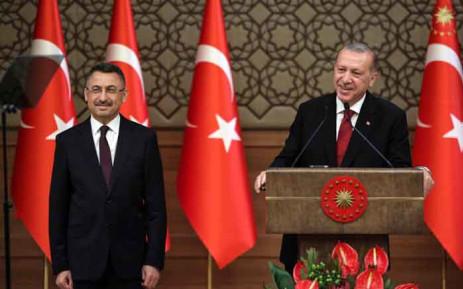 土耳其总统埃尔多安(右)与副总统奧克塔伊(左)。(图:法新社)