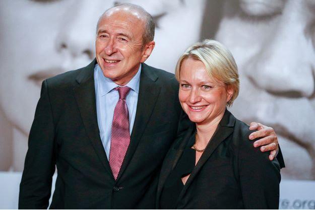 法国前内政部长、里昂市长科隆和现任妻子卡罗琳(图:路透社)