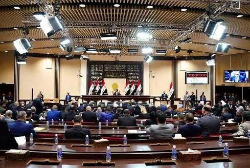 5日伊拉克国民议会通过有关完毕外国军队驻守抉择(图源:新华社)
