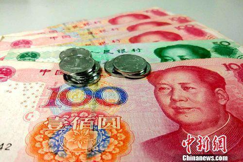 人民币资料图。?#34892;?#32593;记者 李金磊 摄