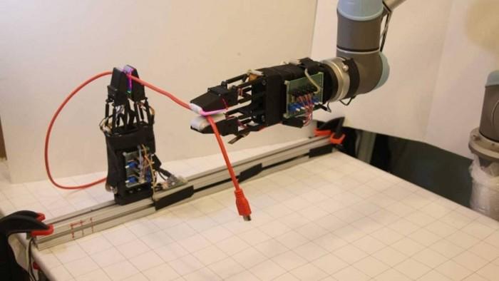 麻省理工研究人员创造了一个带有软抓手的机器人可以操纵电缆