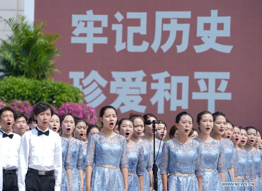 College students sing songs at a ceremony marking the 84th anniversary of the beginning of China's whole-nation resistance war against Japanese aggression at the Museum of the War of the Chinese People's Resistance Against Japanese Aggression in Beijing, capital of China, July 7, 2021. (Xinhua/Yue Yuewei)